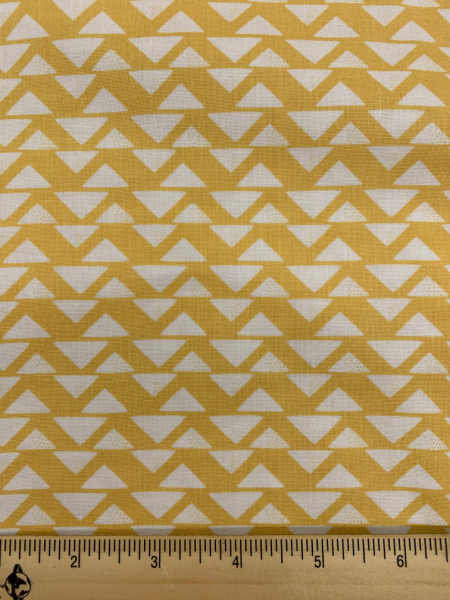 Cream Triangles on a yellow background quilting fabric from Sweet Bee Designs