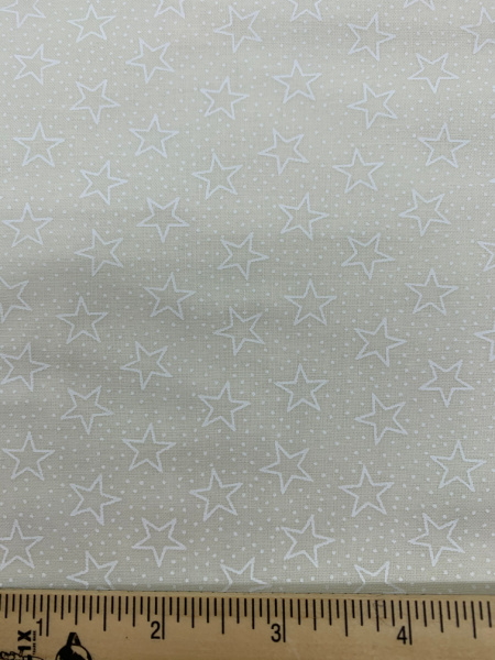 White stars and spot on cream quilting fabric