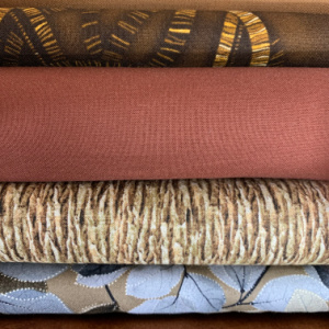 A pile of brown quilting fabrics