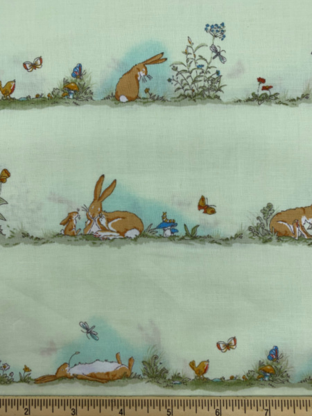 Nut Brown Hare in Rows on Green Quilting Fabric by Sam McBratney from Guess How Much I Love You for Clothworks