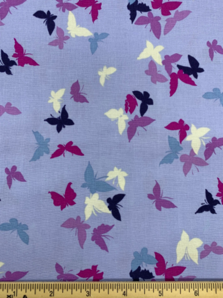 Flutter-By Clouds in Lilac from Sea Holly by Sarah Campbell for Michael Miller
