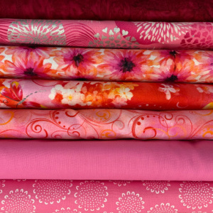 A pile of pink quilting fabrics