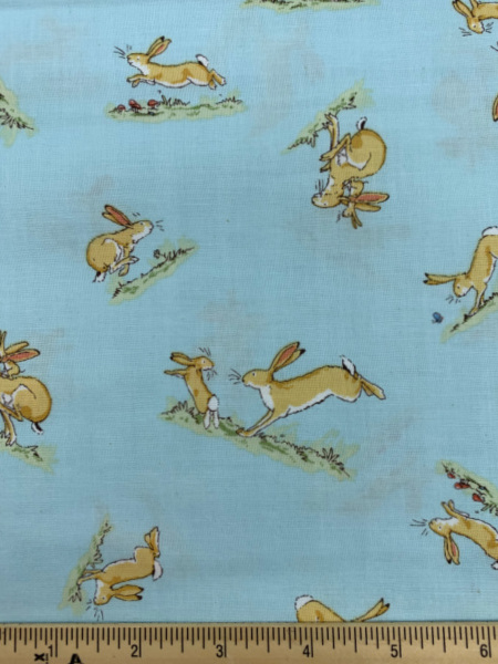 Hare Bouncing on Blue Quilting Fabric by Sam McBratney from Guess How Much I Love You for Clothworks