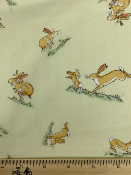 Hare Bouncing on Yellow Quilting Fabric by Sam McBratney from Guess How Much I Love You for Clothworks