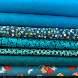 A pile of turquise quilting fabric
