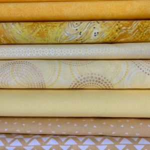 A pile of yellow quilting fabric
